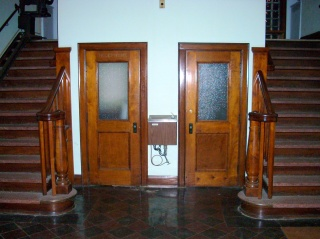 Stairs, a bubbler, and twin phone booths (sans phones)