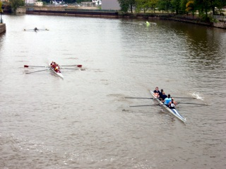 Three teams of the Womens' 4 row past Schlitz Park